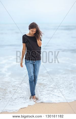 lonely beautiful woman walking on tropical beach. relax concept
