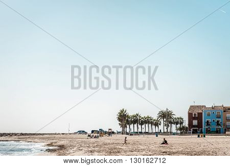 Villajoyosa Spain- February 23 2016: People relaxing on the Villajoyosa beach. Costa Blanca. Province of Alicante Valencian Community Spain