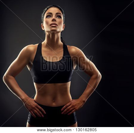 Beautiful fitness woman . Fitness sporty woman showing her well trained body . A beautiful girl's body with rippling muscles from strength training .