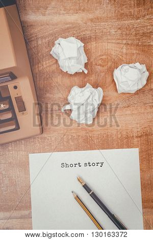 Short story message against view of an old typewriter and paper