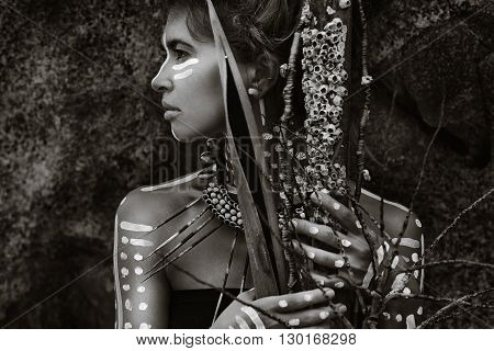 African style woman. Attractive tribal girl outdoors