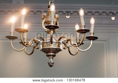 Ornate vintage chandelier light hanging from the ceiling