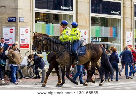 Amsterdam, Netherlands - May 4: This is horse police patrol to reinforce the rule of law on the Day of Remembrance of the Fallen May 4, 2013 in Amsterdam, Netherlands.