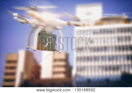 Digital image of a drone holding a cube against low angle view of city buildings
