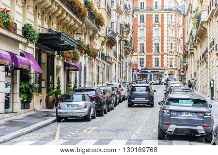 Paris France - September 12 2015: One small street in Paris with cars and beautiful buildings