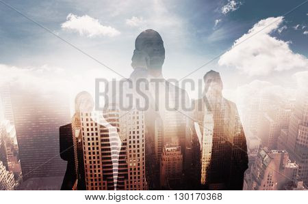 Business colleagues using phones against aerial view of a city on a cloudy day