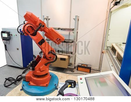 Robotic arm at production line in factory