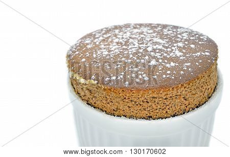 Chocolate souffle in a white ceramic on white background