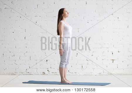 Beautiful Sporty Young Woman Doing Tadasana Pose In White Loft