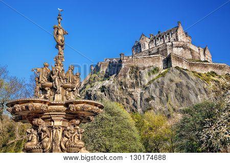 Famous Edinburgh castle with fountain in Scotland