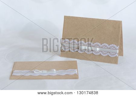 handmade card from kraft paper with lace and bow