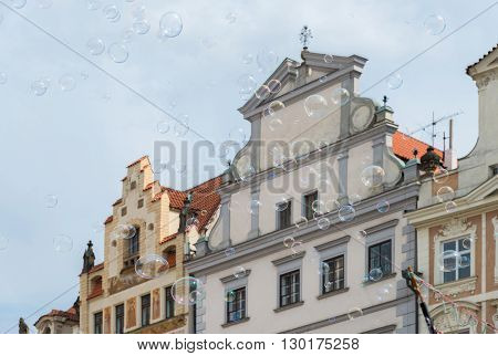 soap bubbles on the background of old houses in Prague