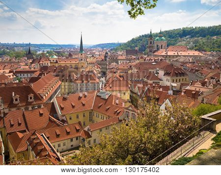 view from above of the houses with red-tiled roofs spring Prague Czech Republic