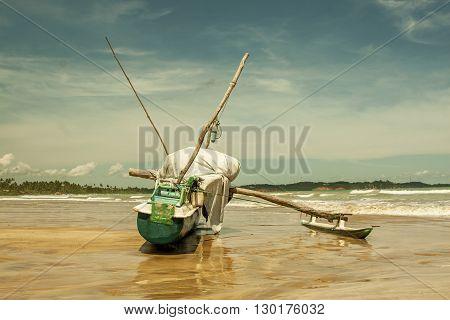 Fishing boat on Sri Lanka coastline and beach at the Indian Ocean