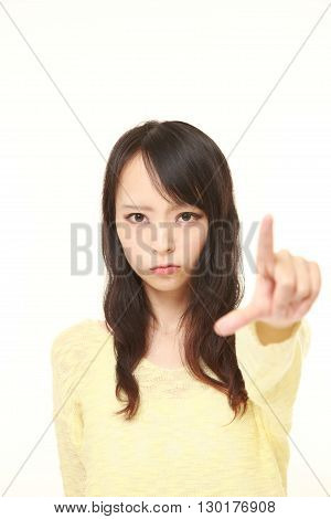 portrait of young Japanese woman scolding on white background