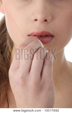 Woman cleaning her face with cotton pads. Lips close-up