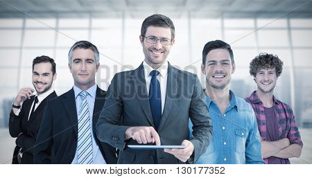Businessman using his tablet pc against modern room overlooking city
