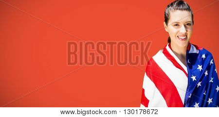Portrait of happy american sportswoman is smiling against red background