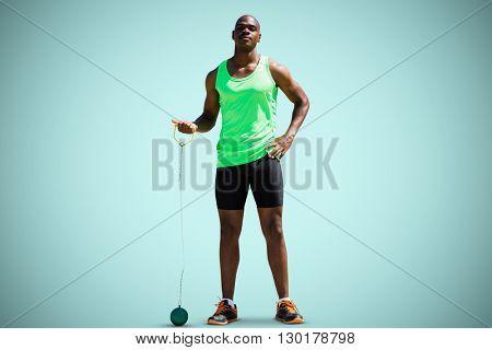 Man preparing to throw marter against blue background
