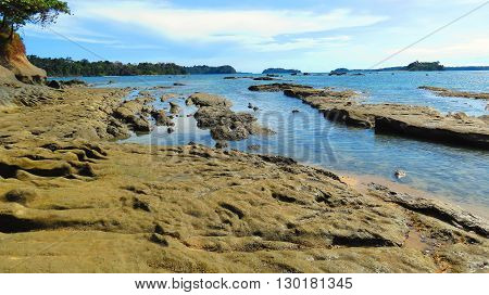 Rough rocky sea beach shore of Wandoor, Port Blair, Andaman and Nicobar Islands, India, Asia.