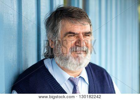 Elderly Man Standing Outside