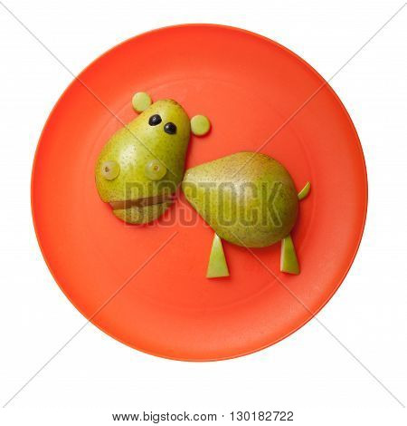 Funny hippo made of peer on orange plate