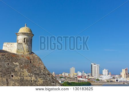 San Filipe de Barajas Castle tower and a view on Cartagena old city Colombia. City panorama with Cartagena city landmarks in the morning.