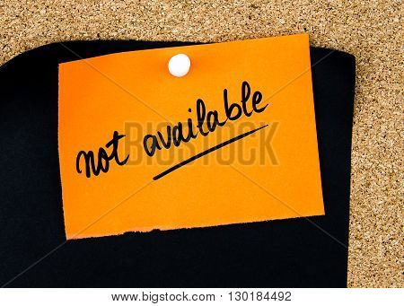 Not Available Written On Orange Paper Note