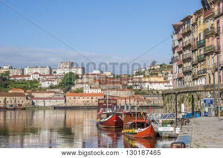 PORTO, PORTUGAL - APRIL 20, 2016: Boats at the Ribeira quay in Porto, Portugal