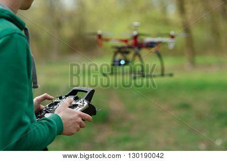 Man controling a drone.