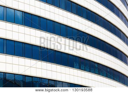 Close-up of the facade of modern building of steel and glass. Modern industrial architecture.
