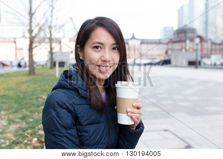Woman having coffee at outdoor