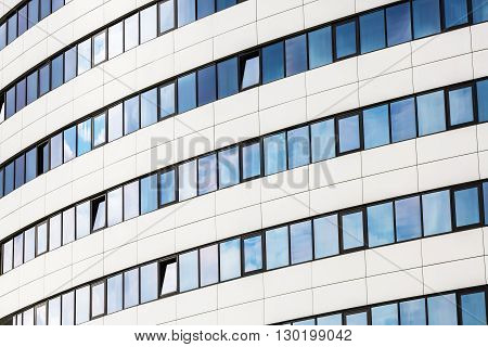 Facade of a modern office building. Modern industrial building made of glass and steel.