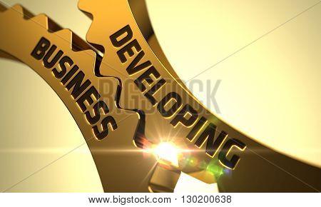 Developing Business on the Mechanism of Golden Cog Gears with Glow Effect. Developing Business - Concept. Developing Business on the Mechanism of Golden Metallic Cogwheels. 3D Render.
