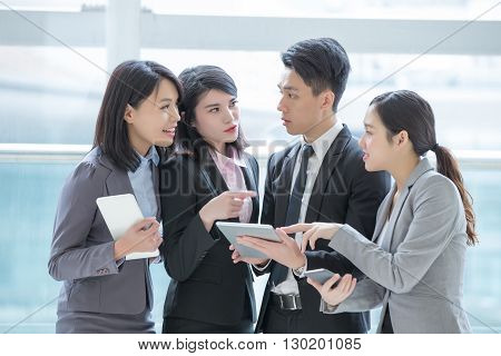 Business people team meeting with computer in the office shot in Hong Kong asian woman and man