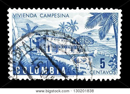 COLOMBIA - CIRCA 1950 : Cancelled postage stamp printed by Colombia, that shows Colombian farm.