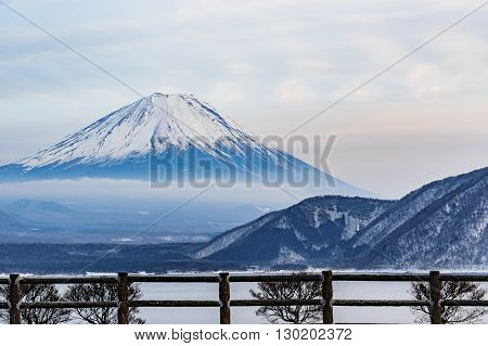 The beautiful Fuji mountain form the peaceful lake in winter. Japan