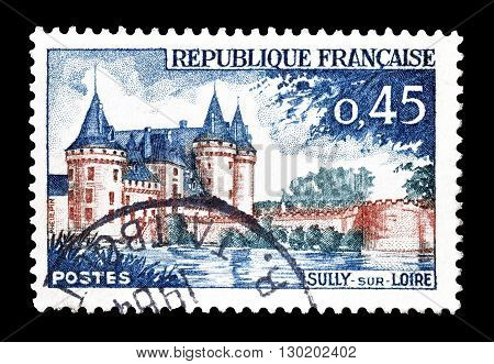 FRANCE - CIRCA 1961 : Cancelled postage stamp printed by France, that shows Sully sur Loire chateau.