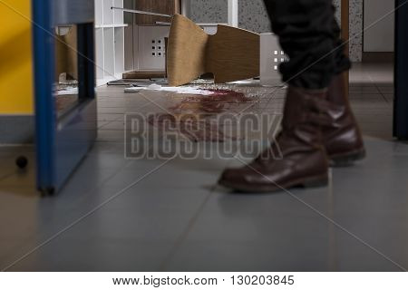 Close up of a man's legs bloody splash on the floor