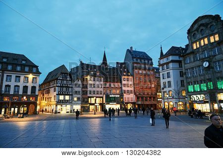STRASBOURG FRANCE - MAR 24 2016: Place Kleber UNESCO World Heritage site in central Strasbourg with tourist admiring the city at the evening