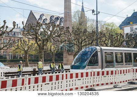 STRASBOURG FRANCE - APR 19 2016: Workers repairing tramway line waiting for the tram to pass over repairing area