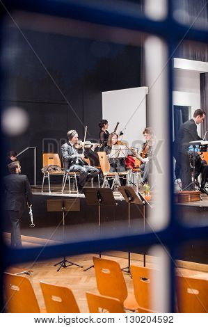 STRASBOURG FRANCE - MAR 18 2016: View through the window of a building at the classical music orchestra preparing for the concert in Strasbourg France