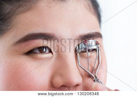 Makeup Artist Using Eyelash Curler On Woman Face