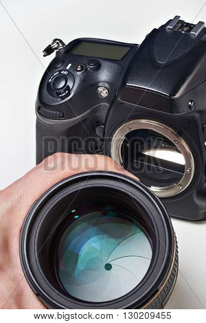 Photographer With Big Lens And Slr Camera
