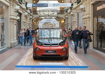 MOSCOW - APRIL 13: People walk near BMW car in GUM store on April 13 2016 in Moscow. This car exhibition dedicated to the 100th anniversary of the BMW company.