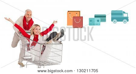 Digital shopping diagram on a white background against mature couple playing with a trolley