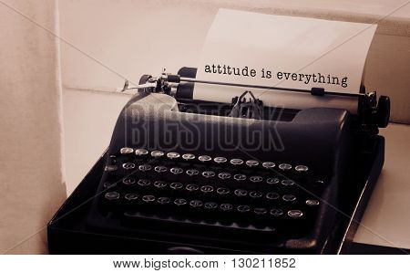 Attitude is everything message on a white background against typewriter on a table