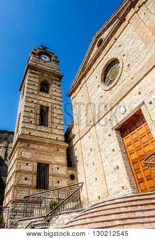 stone-work church and tower bell with clock. Cerchiara di Calabria, Italy