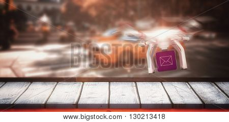 Digital image of a drone holding a cube against picture of a zebra crossing