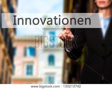 Innovationen (innovationin German) - Businesswoman Hand Pressing Button On Touch Screen Interface.